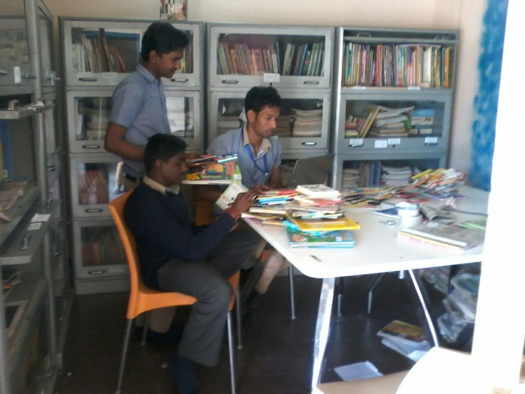 Students helping in cataloguing
